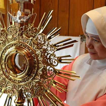 pink sister with monstrance